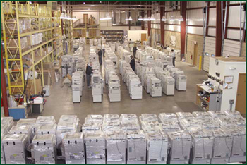 Rows of Copiers in Warehouse
