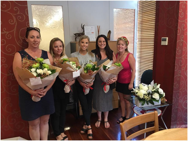 Shire Conveyancer Team With Flowers