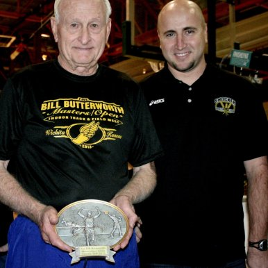 All-American Bill Butterworth, 82, was recognized for his great contributions to the sport of masters track and field on Feb. 26 in Wichita, Kan., when the Bill Butterworth Open/Masters Indoor Track Meet was named in his honor. Presenting Bill with a plaque as a tribute is John Wise, Wichita State University Assistant Director of Track and Field. Thirty-Three All-American Standard performances were recorded at the inaugural indoor meet held at Wichita State University. (Shocker Track Club Photo by Grant Overstake).