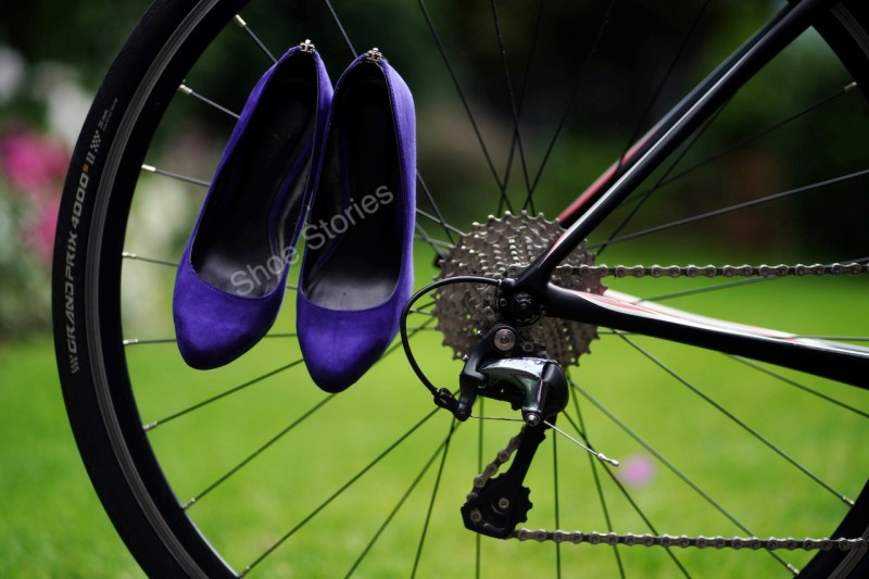 Purple stiletto shoes with a bicycle