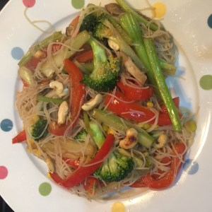 stir fried vegetables with noodles and toasted cashews