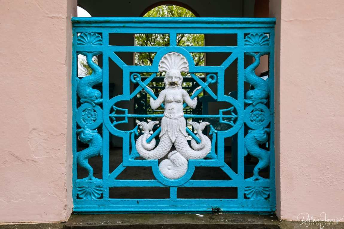 Blue cast iron panels with mermaid detailing at Portmeirion