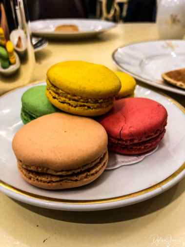 a plate of colourful macarons at meert in lille