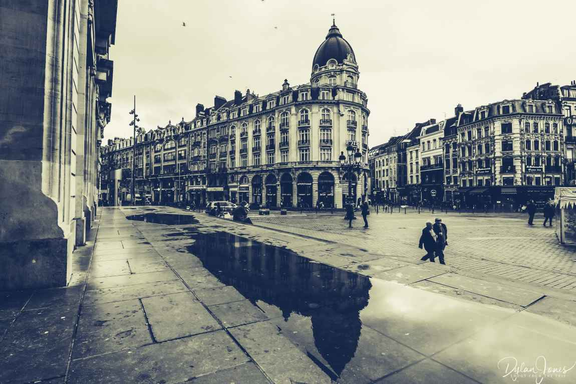Reflection of Hotel Carlton Lille from the steps of the Opera