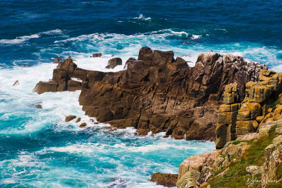 Waves crashing against the rocks at Land's End, South Cornwall coast