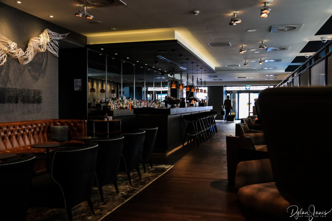 The bar and seating area at Motel One Manchester Royal Exchange