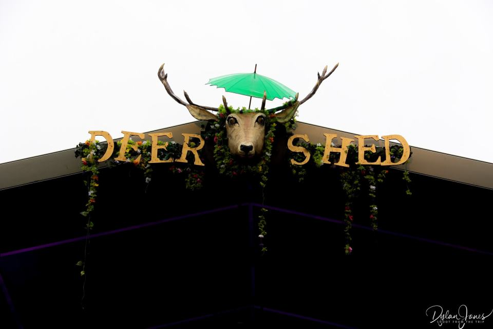 Deer Shed Festival mascot with an umbrella