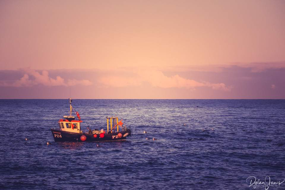 A fishing boat out to sea
