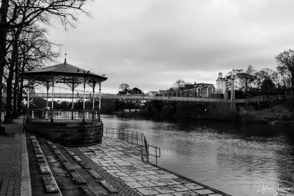 Queens Park Bridge, the Bandstand and the River Dee during a Chester sightseeing trip