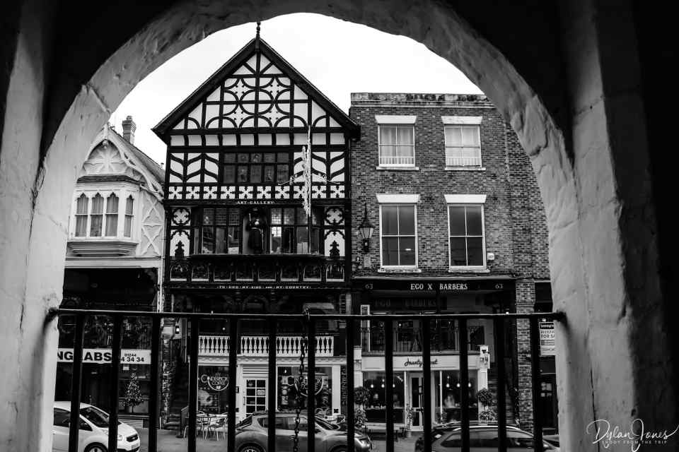 A view from an archway on Chester's famous Rows in black and white