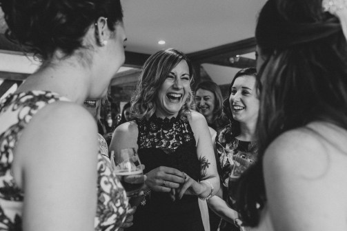 Guests laughing at Bassmead Manor Barn