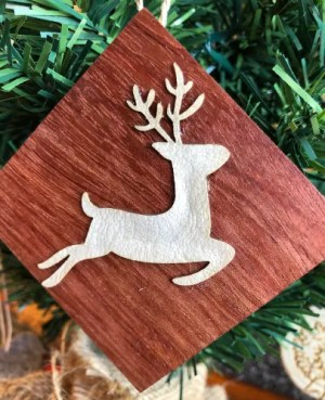 Reindeer on wood Christmas ornament