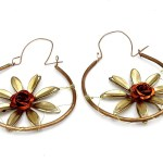 Hoop earrings with brass flowers in center and aluminum rose in red hue.