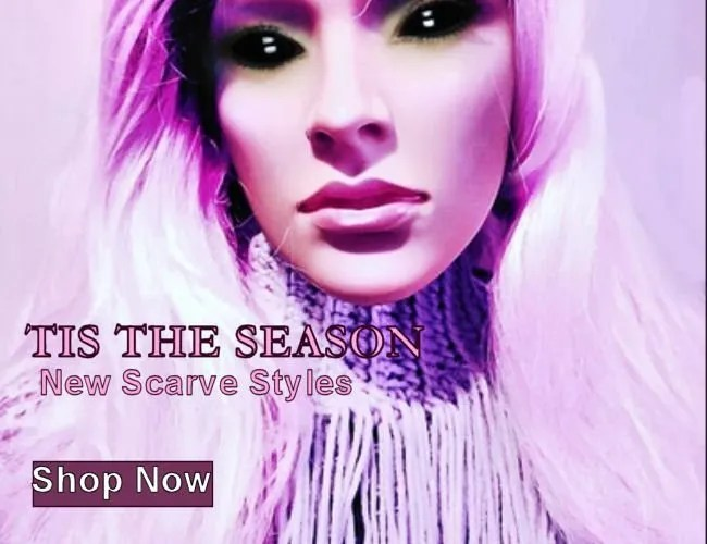 Manniquin wears lavendar scarf with fringe accents