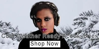 Woman with earmuffs stands in front of winter wonderland