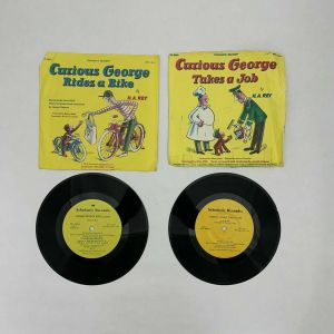 Scholastic Records CURIOUS GEORGE TAKES A JOB and RIDES A BIKE – 33 1/3 RPM