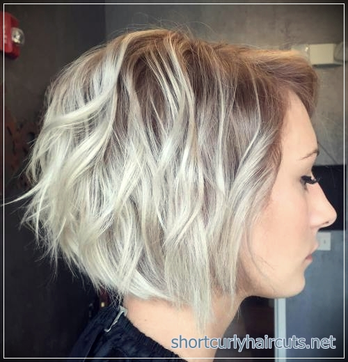 Curly bob with razored layers haircut