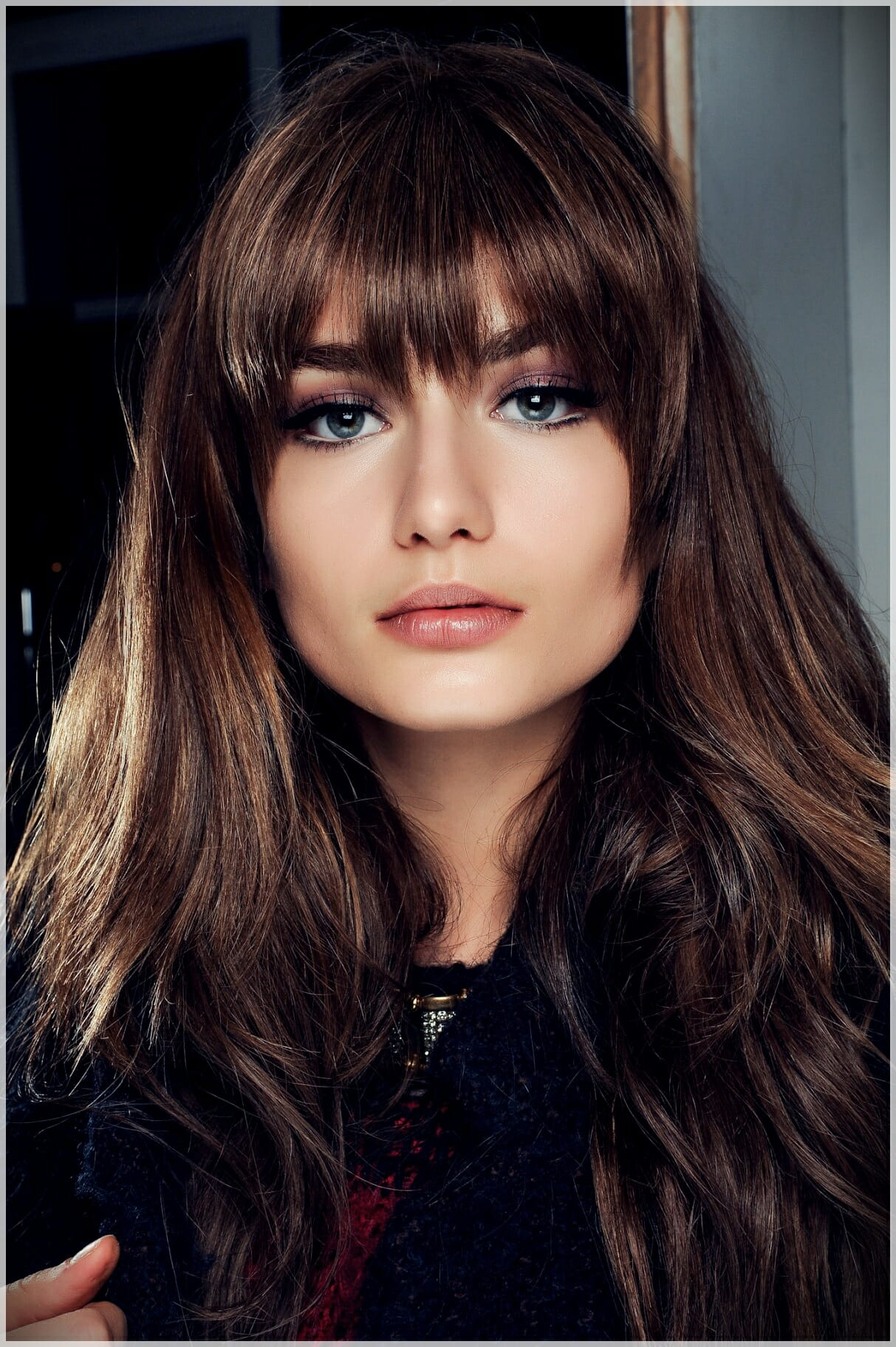 layered haircut with bangs 9 - Why getting bangs will never go out of fashion?