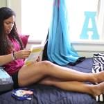 Girl reading in dorm room