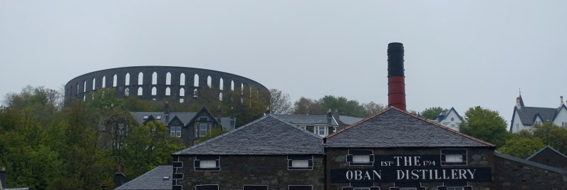 The Oban Distillery with McCraig's Tower in the background.