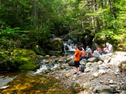 Cold River Camp hikers take a break for a snack on the Blue Brook trail