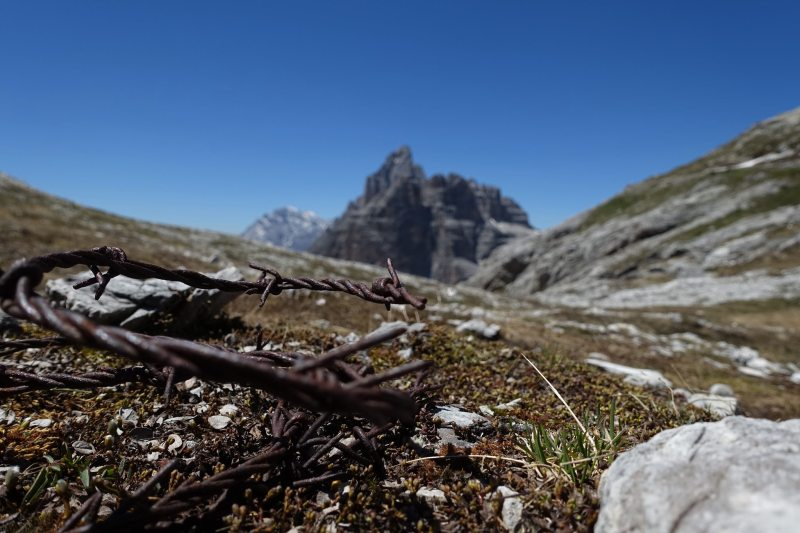 Barbed wire in the Dolomites. Monte Paterno in the background