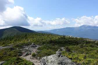 Cairns mark the trail to Carter Dome, with Mount Washington in the distance