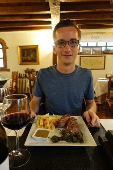 Kyle prepares to eat steak, frites, and peppers at Vicente Campo Restaurante.