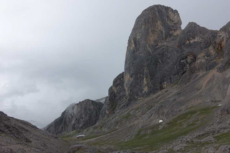 The massive Naranjo de Bulnes towers over Refugio de Urriellu