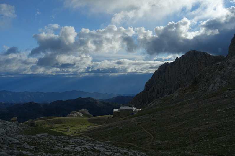 Leaving Refugio de Urriellu in sun and clouds