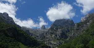 Mountain peaks in clouds, seen from Views in Caín