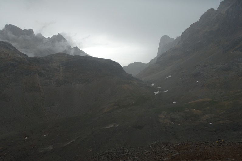 Looking down at Jou de los Bouches in the clouds and rain