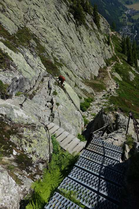 Kyle descends the ladders on the Tour du Mont Blanc