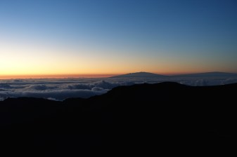 Looking toward the summits of Hawaii during a Haleakala sunrise