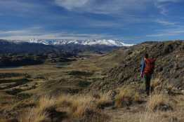 Kyle enjoying a view of the valley and distant snowcapped peaks on the Lagunas Altas hike