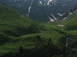 Waterfalls, pastures, and mountains of the Swiss Val Ferret