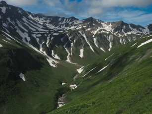 Green and snowy slopes, approaching Grand Col de Ferret