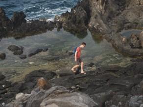 Kyle checking out tide pools along the Kapalua Coastal Trail