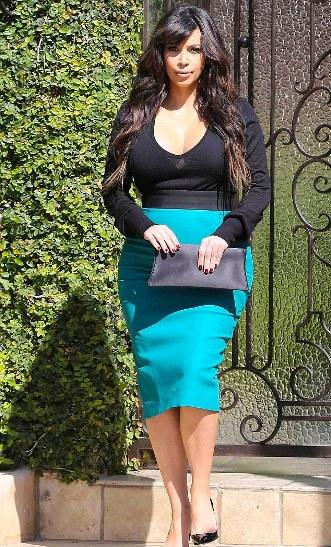 kim in revealing pencil skirt-02-showbizbites