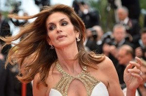 Cindy Crawford's Sleeveless Gown Reveals Deep Cleavage at Cannes Film Festival 2013
