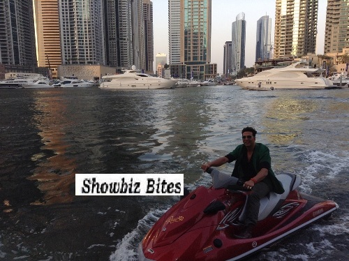 Akshay Kumar enters the press conference on a Jet Ski in Dubai. 03