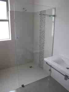 Walk in frameless glass shower enclosure