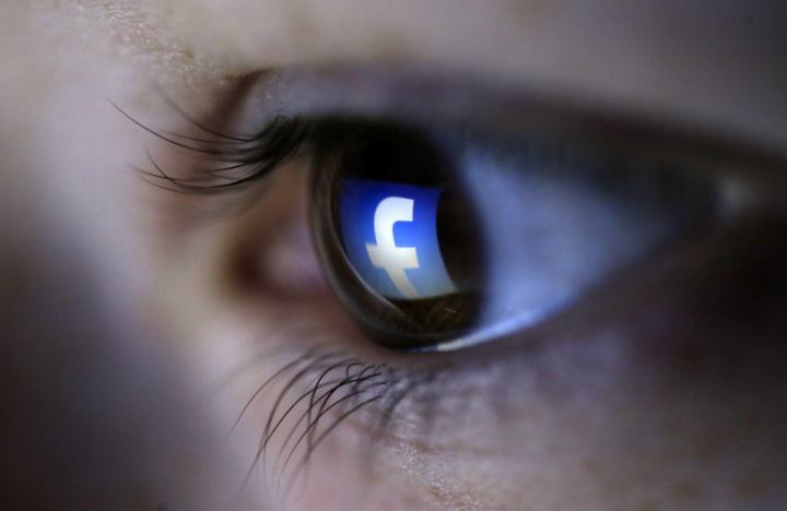 A picture illustration shows a Facebook logo reflected in a person's eye, in Zenica, March 13, 2015. Facebook Inc recorded a slight increase in government requests for account data in the second half of 2014, according to its Global Government Requests Report, which includes information about content removal.Requests for account data increased to 35,051 in the second half of 2014 from 34,946 in the first half, with requests from countries such as India rising and those from others including United States and Germany falling, the report by the world's largest Internet social network showed. Facebook said it restricted 9,707 pieces of content for violating local laws, 11 percent more than in the first half, with access restricted to 5,832 pieces in India and 3,624 in Turkey. Picture taken on March 13. REUTERS/Dado Ruvic (BOSNIA AND HERZEGOVINA - Tags: SOCIETY PORTRAIT SCIENCE TECHNOLOGY BUSINESS TELECOMS TPX IMAGES OF THE DAY) - RTR4TKS2