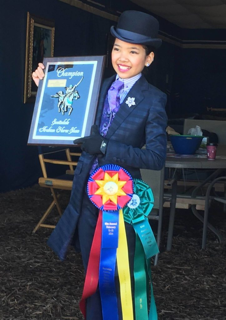 Sophie posing with her championship plaque after her class in Scottsdale