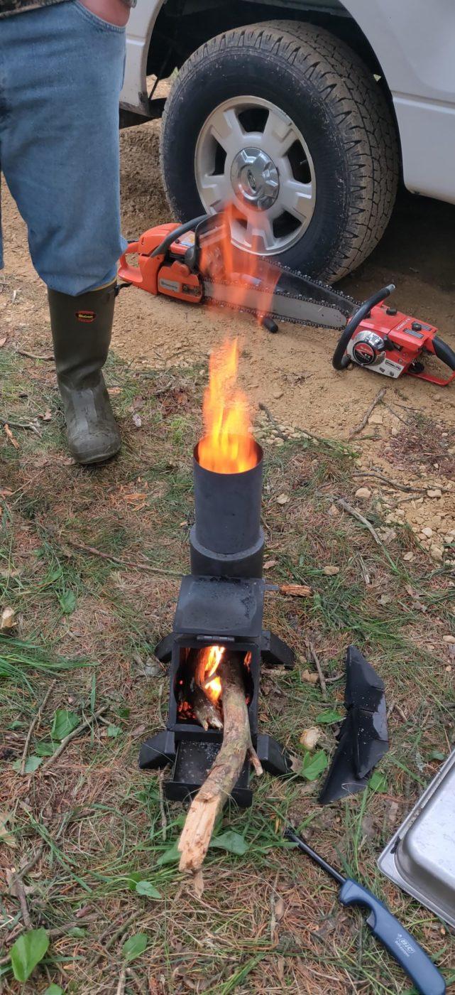 50 BMG Rocket Stove Burning wood camping