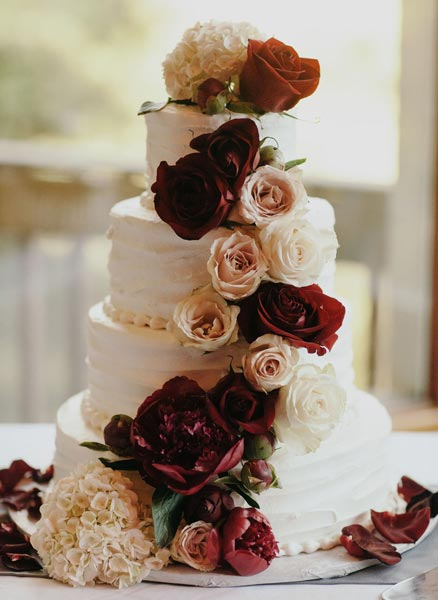 50  Red and White Wedding Color Ideas   Shutterfly Get guests excited for dessert time  Use a tower of white frosted cakes and  decorate with gorgeous red and white flowers