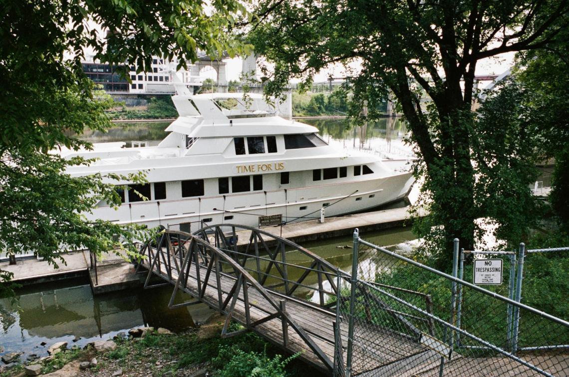 Docked Boat on Riverfront