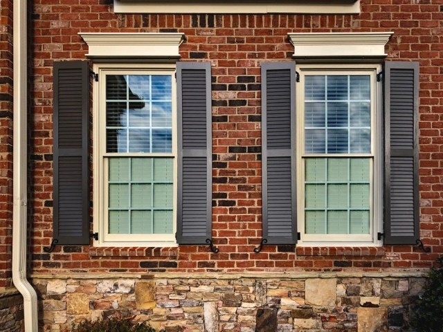 Install louvered exterior shutters on brick.
