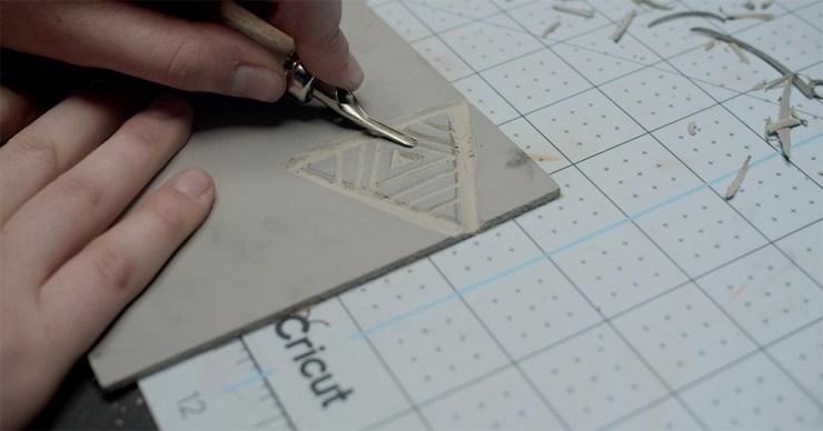 Linocut printmaking step 4: Cut out design or remove excess linoleum around border