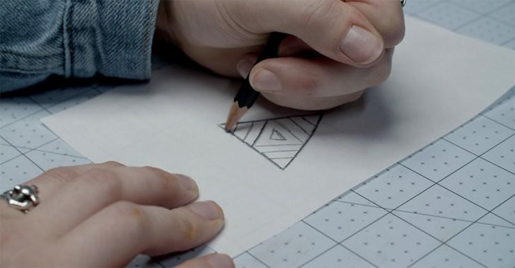 Linocut printmaking step 1: Sketch design onto tracing paper